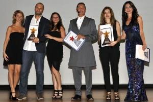 In foto Lucia Ardito e Andrea Del Gobbo, titolari di direWeb, sul palco milanese ritirano i premi durante la cerimonia che ha visto premiate le più importanti agenzie di comunicazione italiane.